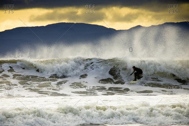 Man surfing, Vancouver Island, British Columbia, Canada