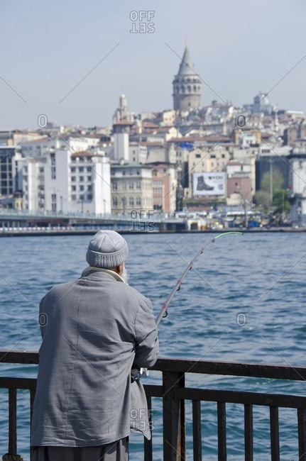 Fisherman on the Golden Horn with Galata Tower beyond, Istanbul, Turkey