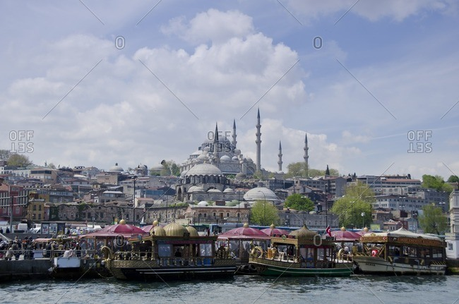 Istanbul, Turkey - May 10, 2011: Floating restaurants and the Rustem Pasha Mosque, located in the Eminou district