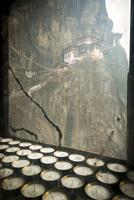 Taktsang (Tigers Nest) Monastery and butter lamps above Paro, Bhutan