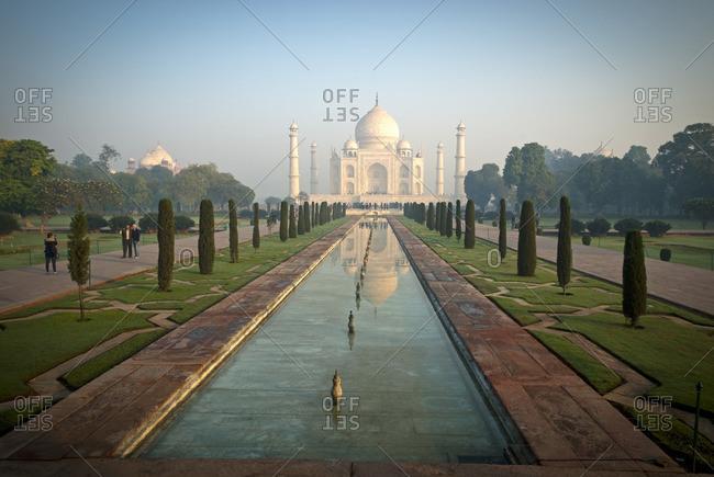 Agra, India - December 4, 2011: The Taj Mahal shines at sunrise