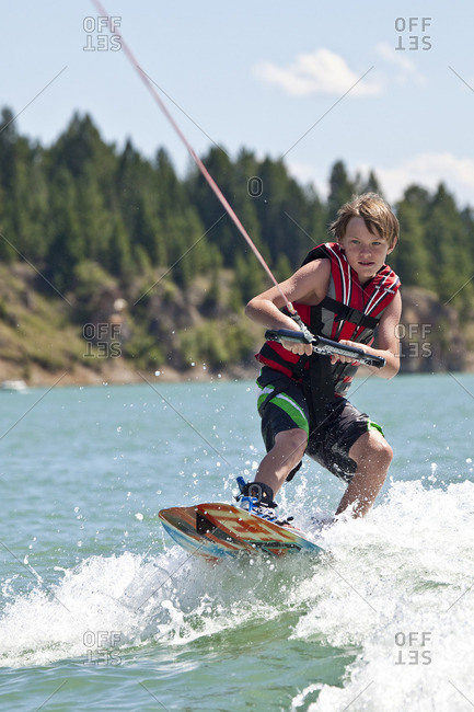 British Columbia, Canada - July 31, 2011: Young boy wakeboarding on Lake Koocanusa, East Kootenays