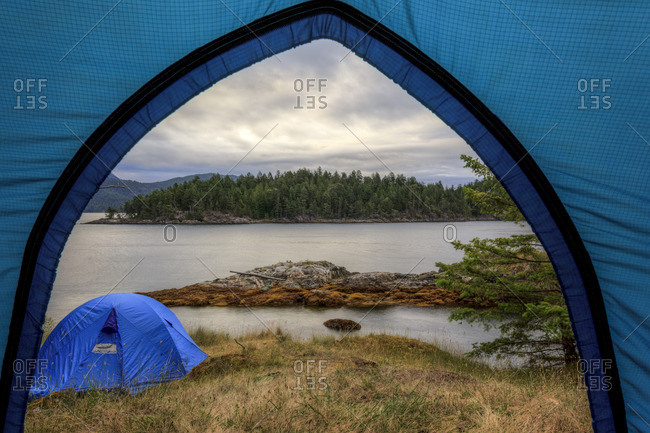 Kayakers camp on Penn Island in Sutil Channel between Read and Cortes Islands British Columbia Canada