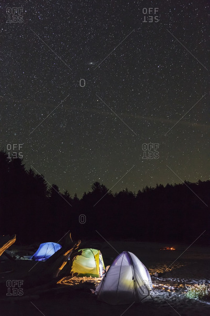 Three tents under the night sky on Vargas Island off the west coast of Vancouver Island British Columbia, Canada