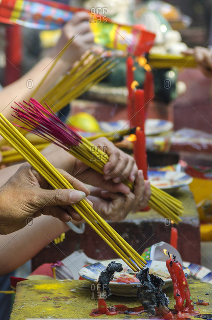 Worshipers burn incense candles at a Chinese temple in Ho Chi Minh City