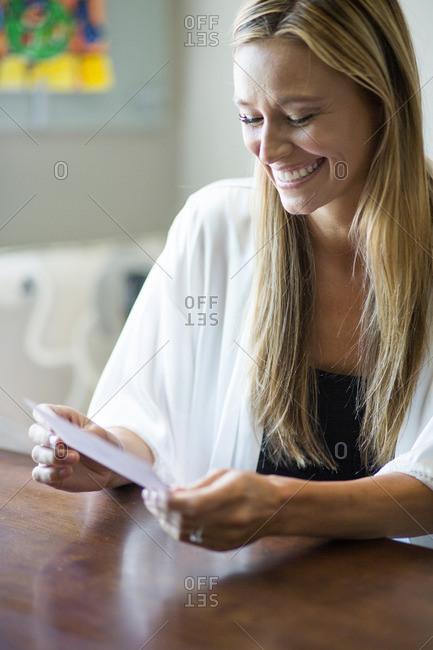 Caucasian woman reading invitation