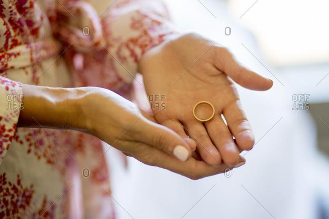 Caucasian woman holding wedding ring