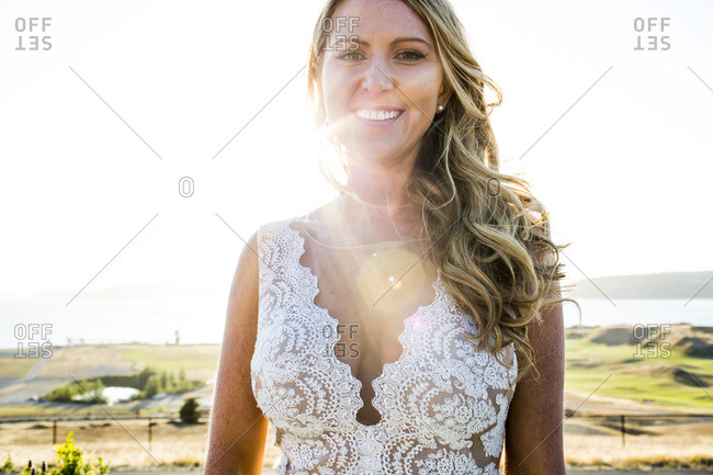 Caucasian bride smiling on sunny day