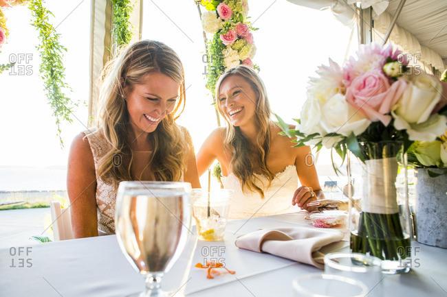 Caucasian brides sitting at table