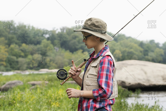 Boy carrying fishing rod