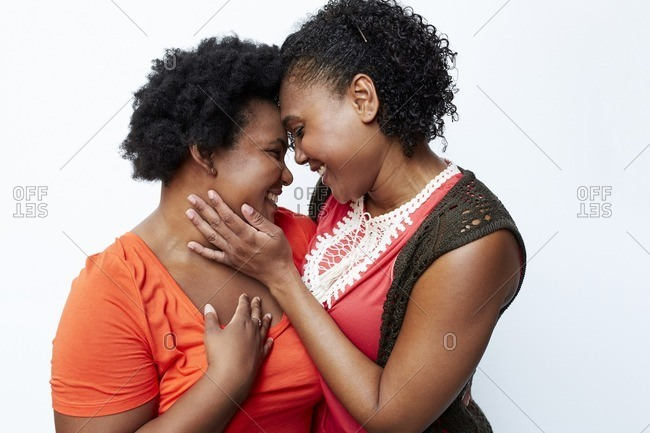 Smiling mother and daughter hugging