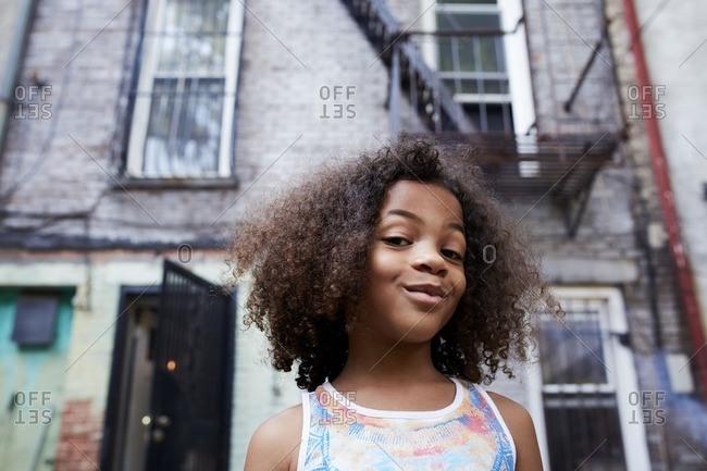 Portrait of smirking Mixed Race girl