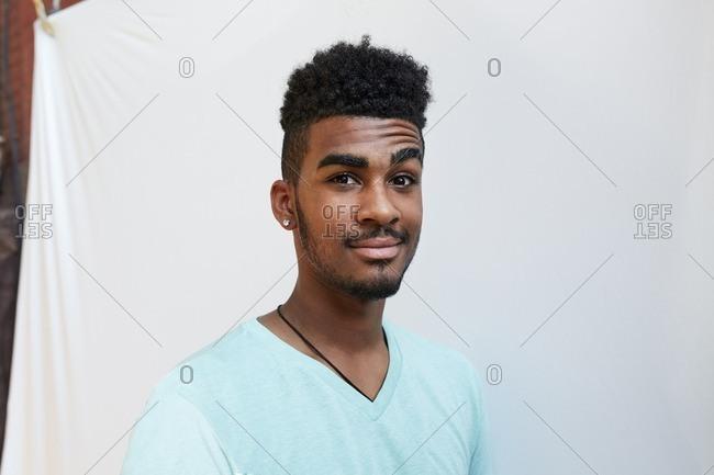 Portrait of smiling Black man raising eyebrow