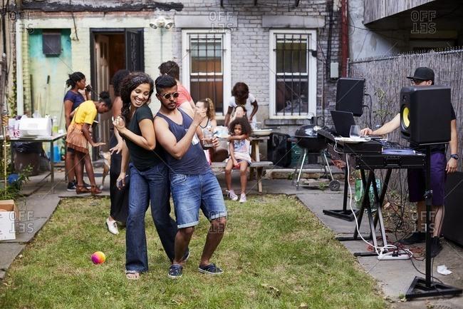 Couple dancing at backyard party
