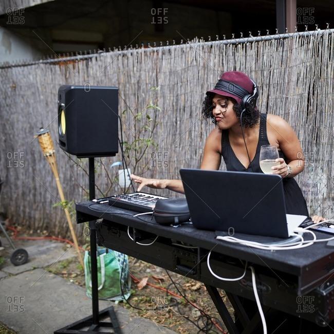 Mixed Race do playing music in backyard