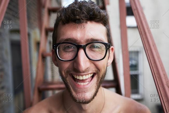 Portrait of Caucasian man on urban fire escape