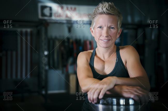 Smiling Caucasian woman posing in gymnasium