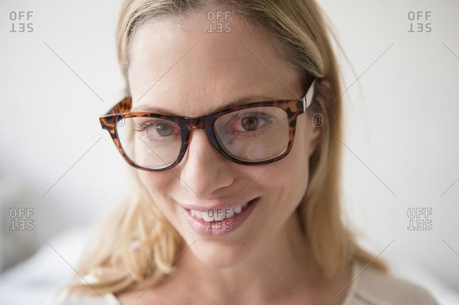 Portrait of smiling Caucasian woman wearing eyeglasses