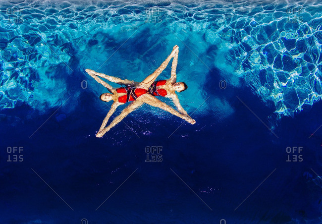 Aerial view of Caucasian synchronized swimmers