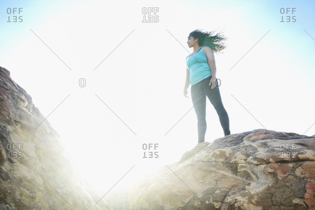 Mixed Race woman standing on rock