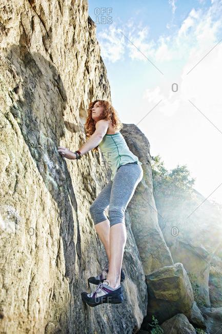 Caucasian woman rock climbing