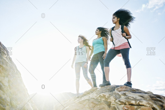 Women standing on rock