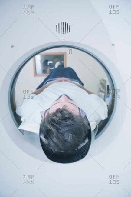 Hispanic patient in scanner - Offset