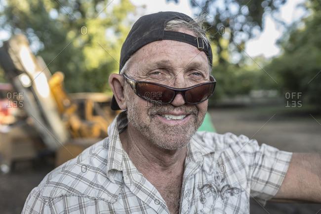 Portrait of Caucasian man wearing sunglasses and baseball cap