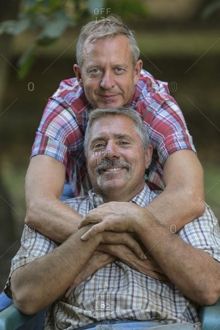 Portrait of smiling Caucasian men hugging
