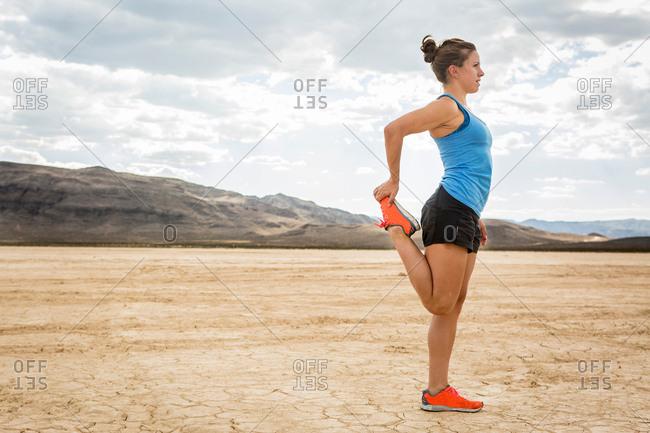 Runner stretching in desert, Las Vegas, Nevada, USA