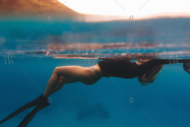 Woman free-diving in sea