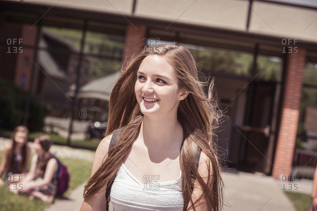 Female high school student leaving high school
