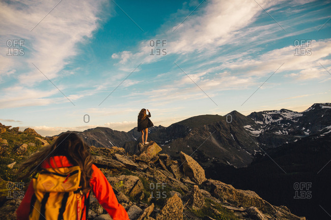 Women on rocky outcrop looking at view, Rocky Mountain National Park, Colorado, USA