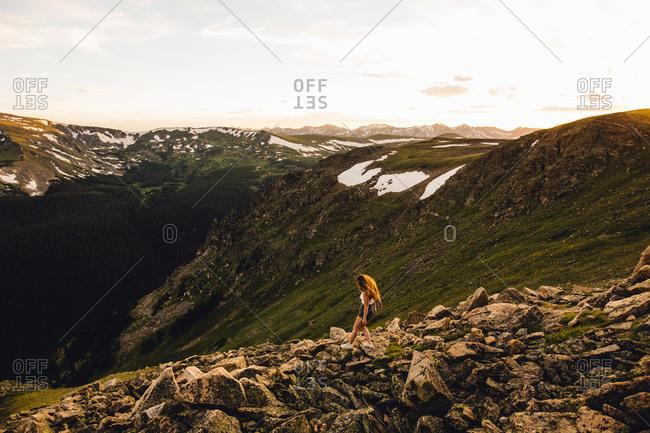 Woman on rocky outcrop, Rocky Mountain National Park, Colorado, USA