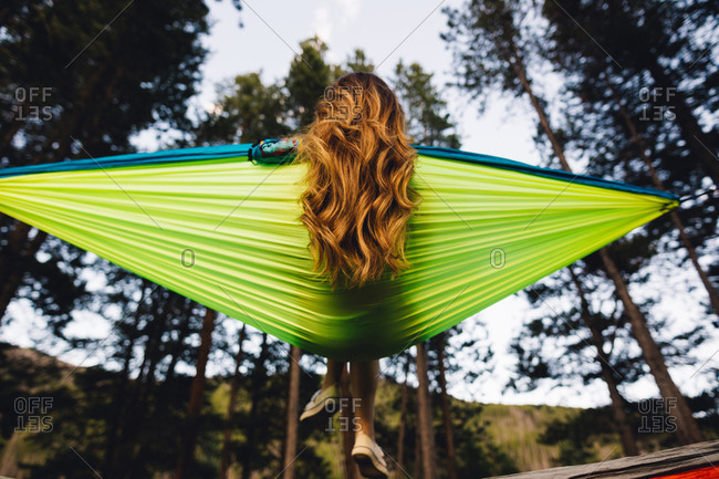 Rear view of woman sitting in hammock, Rocky Mountain National Park, Colorado, USA