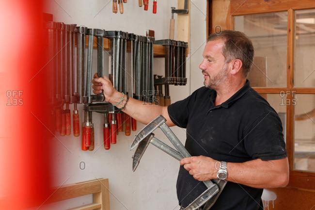 Man selecting hand tool