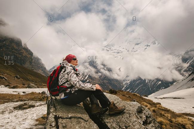 Woman, sitting, looking at view,  ABC trek (Annapurna Base Camp trek), Nepal