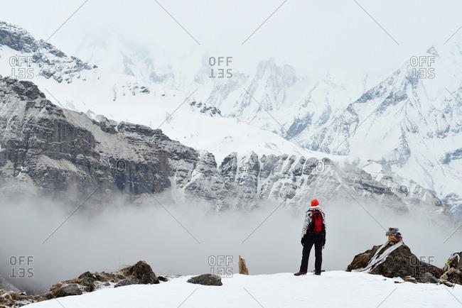 Woman, standing, looking at view,  rear view, ABC trek (Annapurna Base Camp trek), Nepal