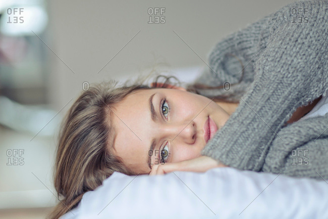 Portrait of woman lying down looking at camera