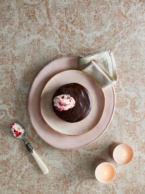 Chocolate pudding with dollop of cream