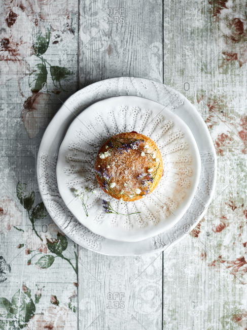 Tart served on lace-patterned plate
