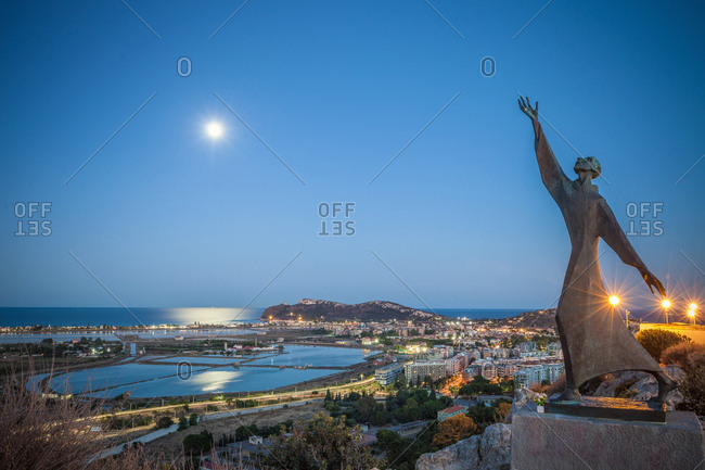 Sardinia, Italy - July 18, 2016: Statue of Saint Francis of Assisi overlooking Cagliari, Masua, Sardinia, Italy