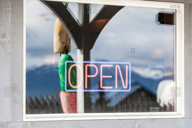 Neon open sign on window, Homer Spit, Kachemak Bay, Alaska, USA