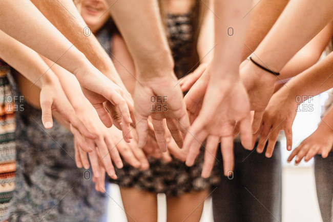 Close up of high school students dancing with hands together in dance class