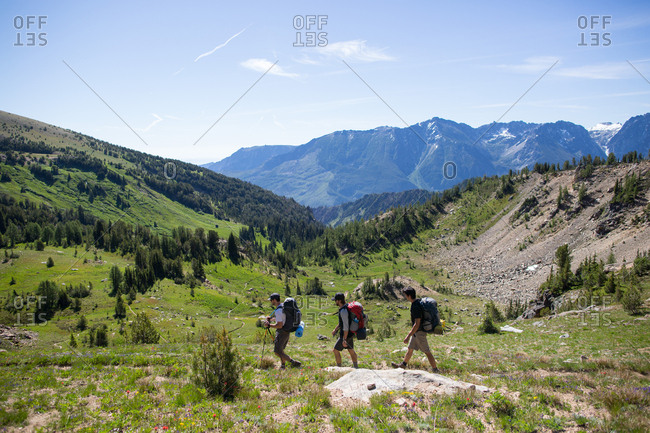 Hikers walking across valley, Enchantments, Alpine Lakes Wilderness, Washington, USA