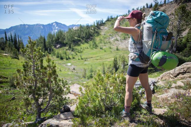 Hiker enjoying view, Enchantments, Alpine Lakes Wilderness, Washington, USA