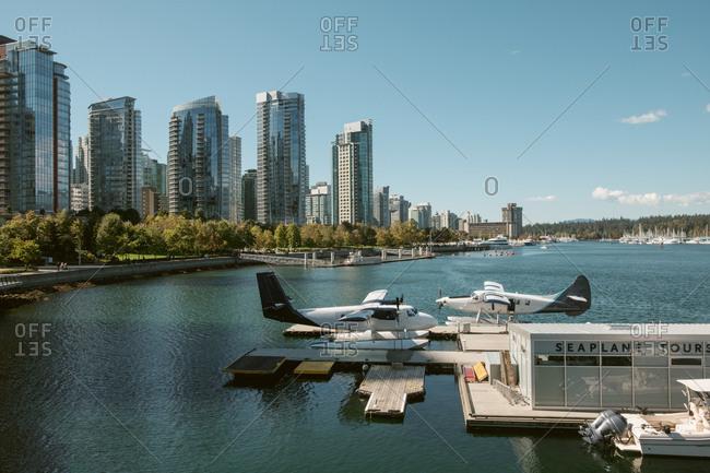 British Columbia, Canada - February 2, 2015: Sea plane and skyline, Vancouver, British Columbia, Canada