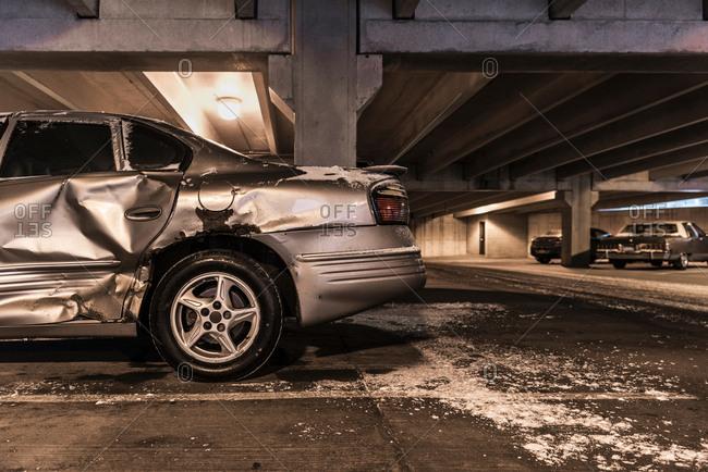 Damaged car in underground parking lot