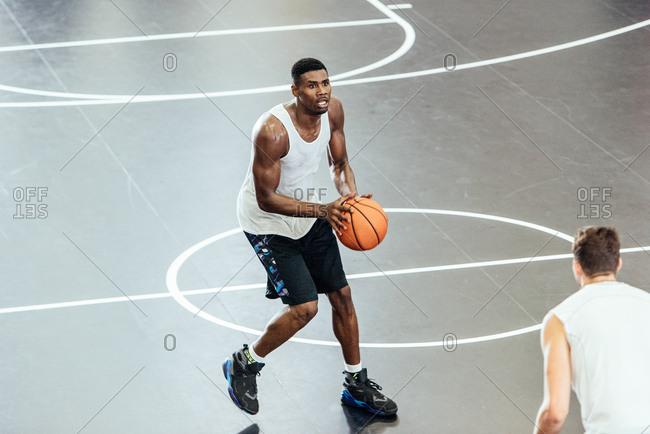Male basketball player preparing aim on basketball court