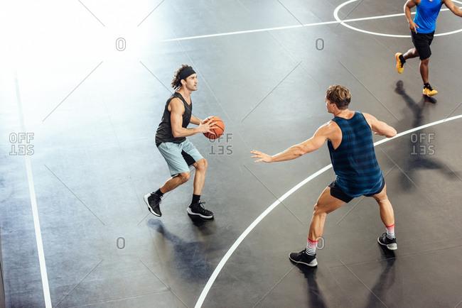 Male basketball player preparing to throw on basketball court